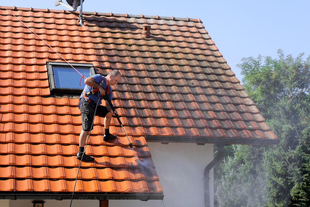Cleaning your roof is not a simple task and doing it yourself is not advisable